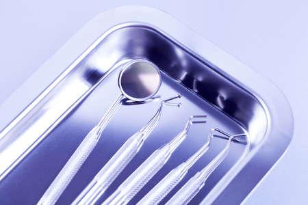 set up: Professional dental tools in a sterile medical light