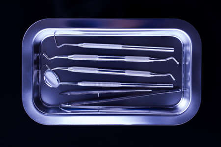 office tool: Professional dental tools in a sterile medical light