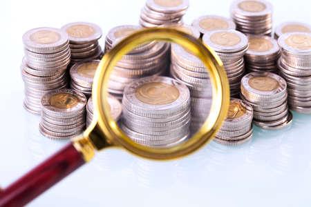 home finances: Money under loupe. Zoom on home finances. Studio shot Stock Photo