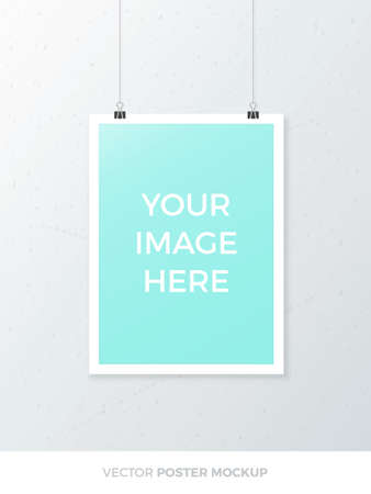 frame wall: Blank hanging A4 poster mockup isolated on grey wall. Realistic A3 white sheet mock up template with paper clip