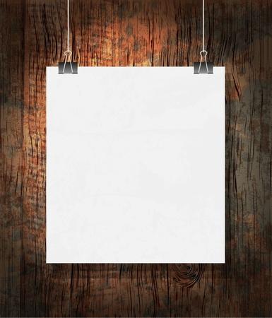 Blank on the paper clips. On dark grunge background.