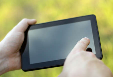 holding and touching on tablet pc  Close-up image Stock Photo - 14792196