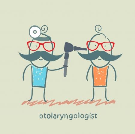 otoscope: otolaryngologist examines the patients ear