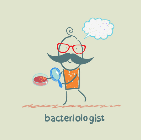 microbes: bacteriologist looks through a magnifying glass on microbes