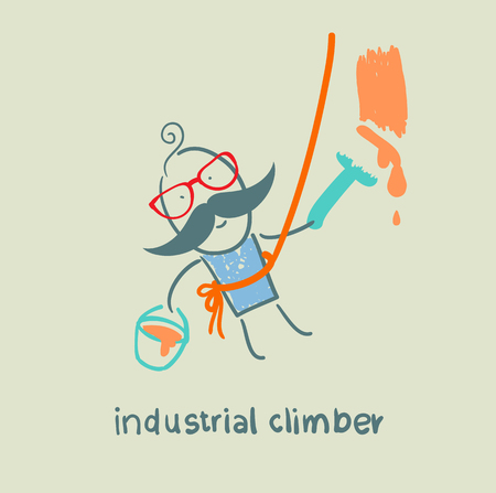 safety harness: industrial climber paints the wall