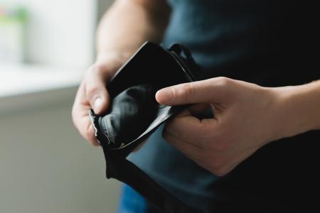 empty: Man holding an empty wallet