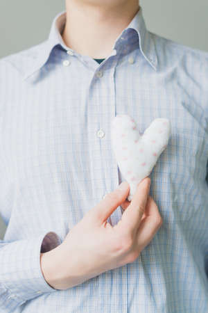 A man holds a heart in his hand photo
