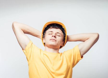 Worker in yellow helmet resting photo