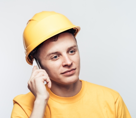 sawhorse: Male worker talking on mobile phone Stock Photo