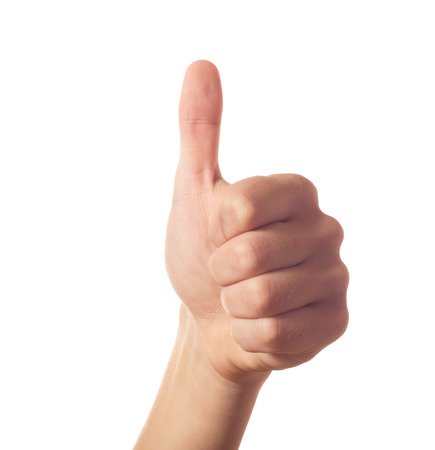 Gesturing one human hand with thumb up Stock Photo