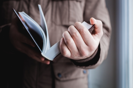 Man reading. Book in his hands. Stock Photo