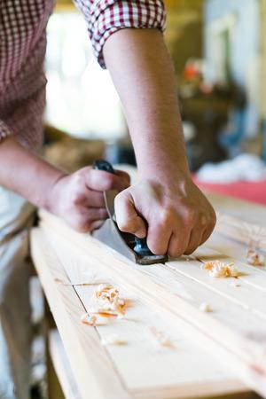 carpenter's sawdust: carpenter working with wood