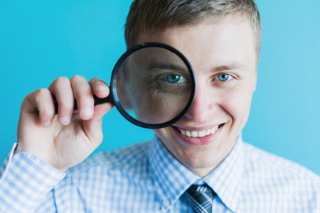 businessman with a magnifying glass photo