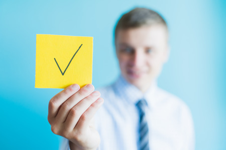 man holding a sign character and the icon for the approved concept design and web graphics. Stock fotó