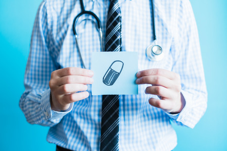 Doctor holding a pill