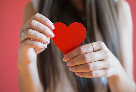 Picture icon paper heart in hand photo