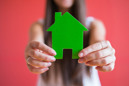 dream house: drawing paper house icon in the hand Stock Photo