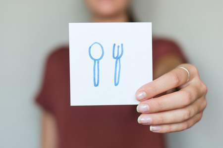 Picture icon in the hands spoon fork