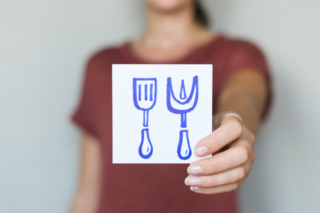 Picture icon in the hands of spatula and fork photo