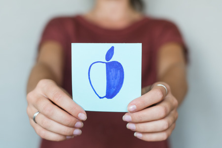 ripened: Picture icon in the hands of apple Stock Photo