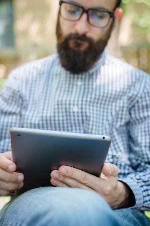 businessman using touch pad of tablet pc photo