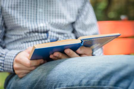book in hand closeup photo