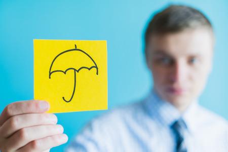 Hand with umbrella  icon photo
