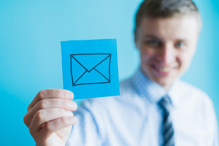 email: hand with email icon
