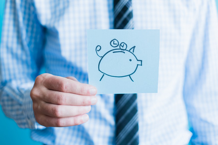 Man holding piggy bank icon. Concept of time is money photo