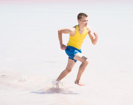 running man in water of sea Stock fotó