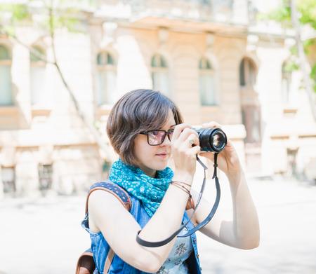 female tourist photographing photo