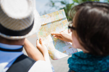 female tourist looking map photo