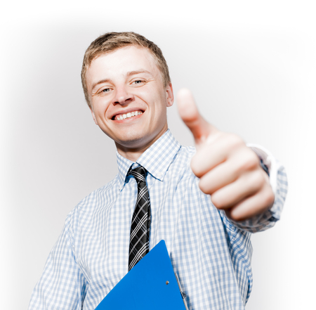 Handsome young business man hold hand with thumb up gesture, businessman excited happy smile, wear elegant shirt and tie isolated over white background photo