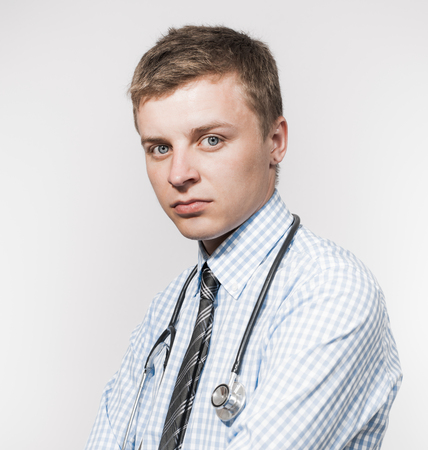 serious guy: Portrait of serious male doctor with stethoscope