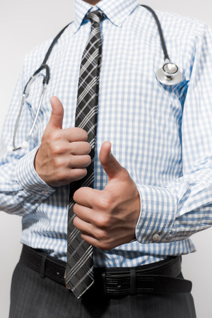 stethoscope and a thumbs up photo