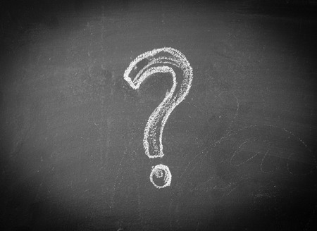 question concept: Question mark drawn in chalk on a blackboard