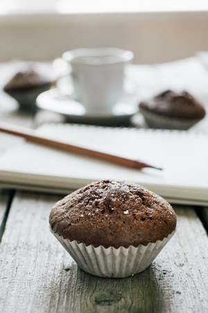 Coffee and muffins, notepad and pencil Stock Photo