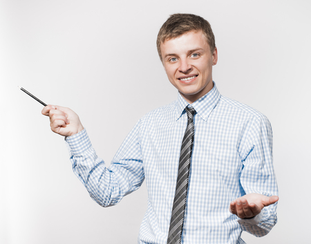 man pointing a pencil photo