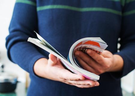 Man reads magazine