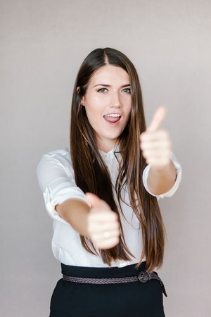 thumbs up woman: Happy beautiful woman showing thumbs up Stock Photo