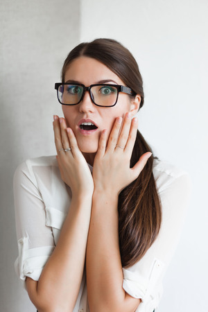 young woman surprised than Stock Photo