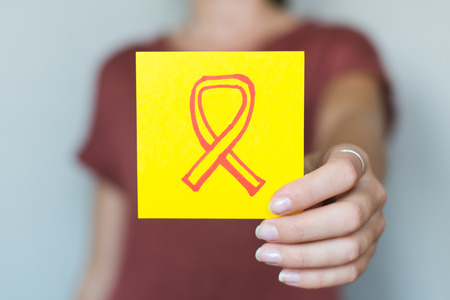 fight disease: Picture icon in the hands of Fighting AIDS Stock Photo