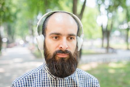 listens: man listens music with headphones