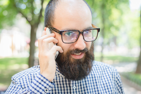bristly: Young man talking on mobilephone Stock Photo