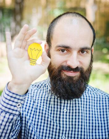 bearded: bearded man thinking with light bulb