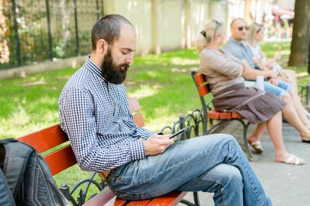 man reading an e-book Editorial