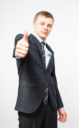 man giving thumbs up sign photo