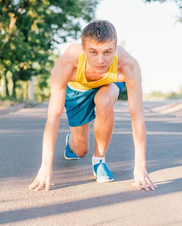 start position: Runner in start position. Stock Photo