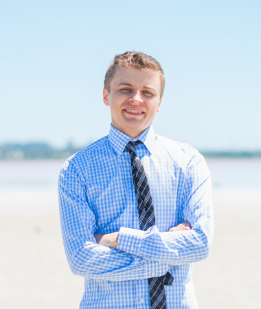 Portrait of happy young man on a tropical beach Stock Photo