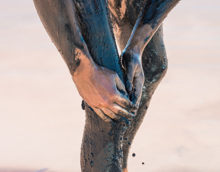 health resort treatment: Mud treatment at the Dead Sea Stock Photo